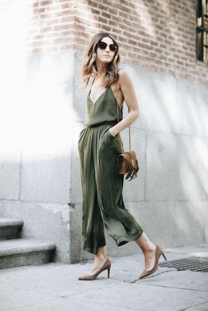 With pumps and brown fringe bag