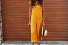 With straw hat and lace up sandals