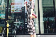 With straw hat, floral bag and black lace up sandals