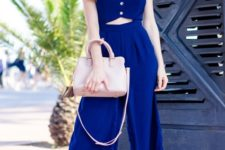 With straw hat, pale pink bag and blue sandals