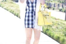 With straw hat, yellow bag and yellow flats