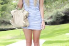 With striped dress and white bag