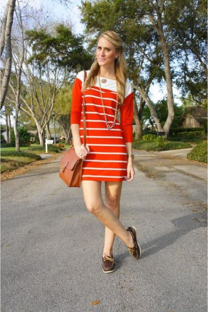 With striped mini dress and brown bag