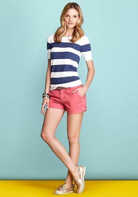 With striped shirt and pink shorts