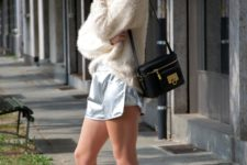 With sweatshirt, gray sneakers and black small bag