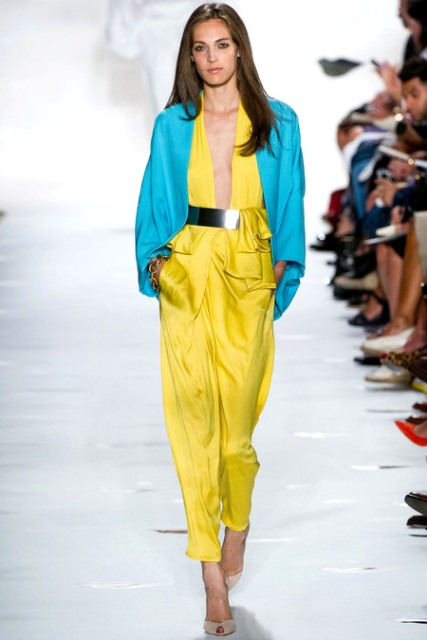 With turquoise cape, neutral heels and metallic belt