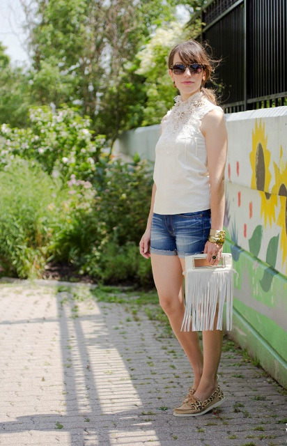 With white lace top, mini shorts and fringe bag