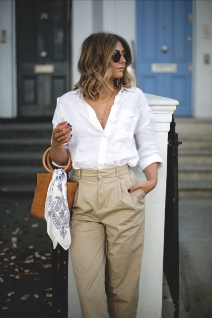 With white shirt and high-waisted pants