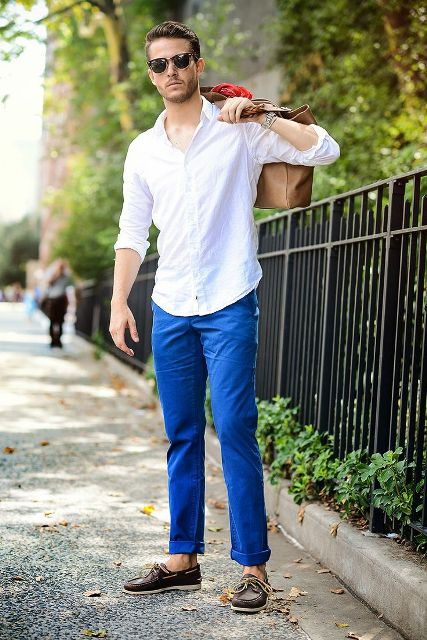 With white shirt, cobalt blue pants and brown bag