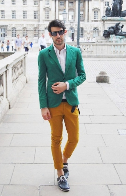 With white shirt, mustard yellow pants and green jacket