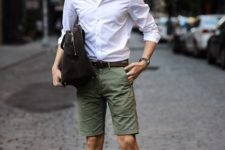 With white shirt, olive green shorts and black bag