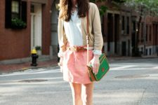 With white shirt, pink skirt and green bag