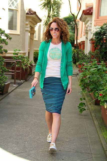 With white t-shirt, green blazer and pencil skirt