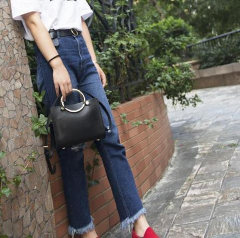 With white t shirt, high waisted jeans and red shoes
