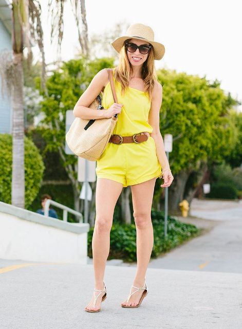 With wide brim hat, brown belt, flat sandals and beige bag