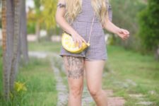 With yellow flats and bag