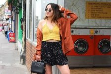 With yellow top, printed skirt, jacket and mules