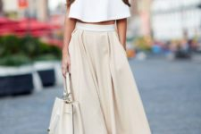 02 a creamy midi skirt, a white crop top with sleeves, a neutral bag and snake print shoes