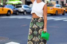 02 a white crop top, a printed tropical-inspired midi skirt, black and white heels and a green bag