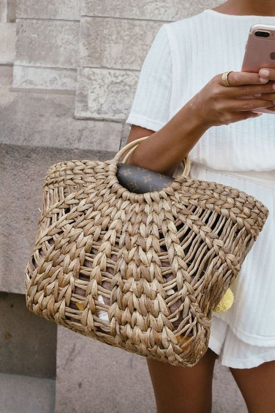 a woven bag with wooden ring handles is all-time summer classics both for the beach and city