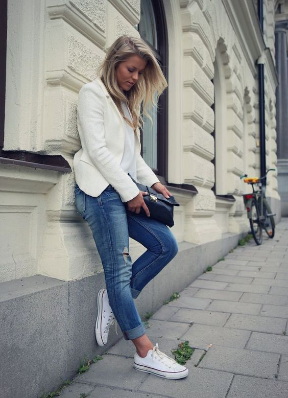 an all-white look with blue distressed jeans and Converse for late summer