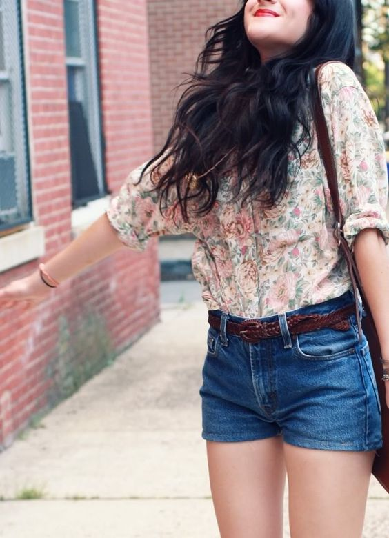 blue denim high waisted shorts, a floral blouse with a pink rose print