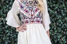 02 white mini dress with ruffled sleeves and colorful floral embroidery on the bodice