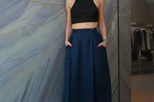 03 a black halter neckline crop top, a navy midi skirt with pockets and ankle strap heels