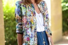 03 a blue mini skirt, a white top, a bold floral bomber and a tote