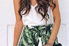 03 a simple white top and a tropical leaf print mini skirt, a black crossbody