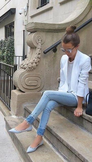 a white blazer, a white top, light blue jeans and light blue spike flats
