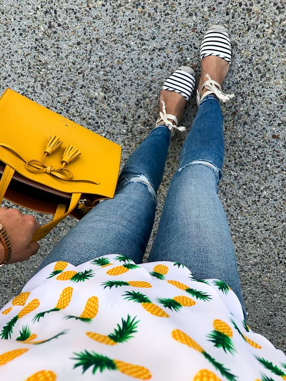 distressed jeans, a pineapple printed top, lace up espadrillas and a mustard bag