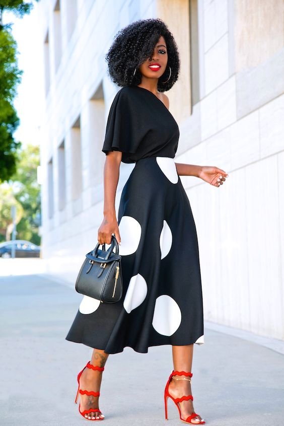 Picture Of A Black One Shoulder Top A Black And Large White Polka Dot Midi Skirt And Red