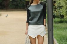 04 a black sweatshirt with a leather bodice and a geo white mini skirt, strappy heels