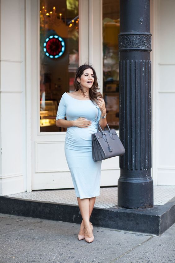a blue knee dress with a bateau neckline and short sleeves, nude shoes and a grey tote