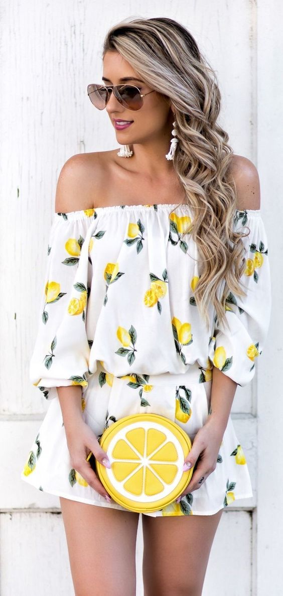 a lemon print off the shoulder dress and a lemon slice clutch for a fruity look