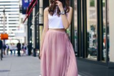 04 a white halter neckline crop top and a pink pleated midi skirt, white heels and a bag