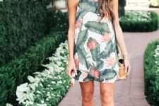 04 cream palm leaf print mini dress with a halter neckline and nude shoes