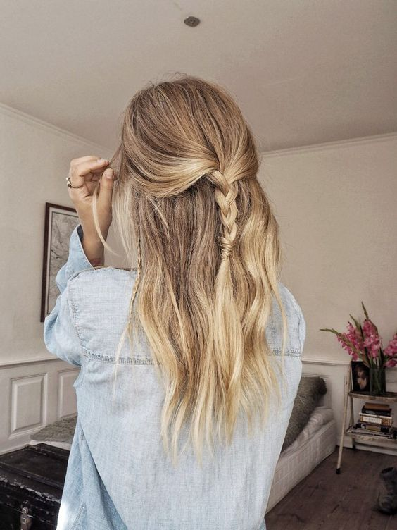 half updo with loose hair and several simple braids here and there