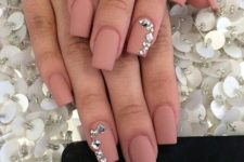 04 matte pink nails with large silver rhinestones look chic