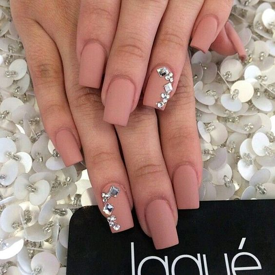 matte pink nails with large silver rhinestones look chic
