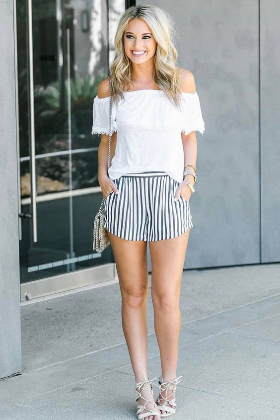 striped shorts, a white off the shoulder top, tassel heeled sandals