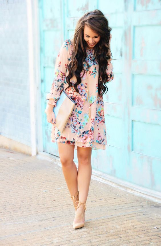 a blush mini dress with a colorful floral print and nude lace up shoes