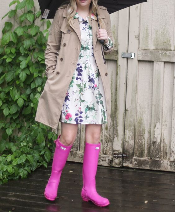 a floral knee dress, a neutral raincoat and pink rain boots for a girlish look