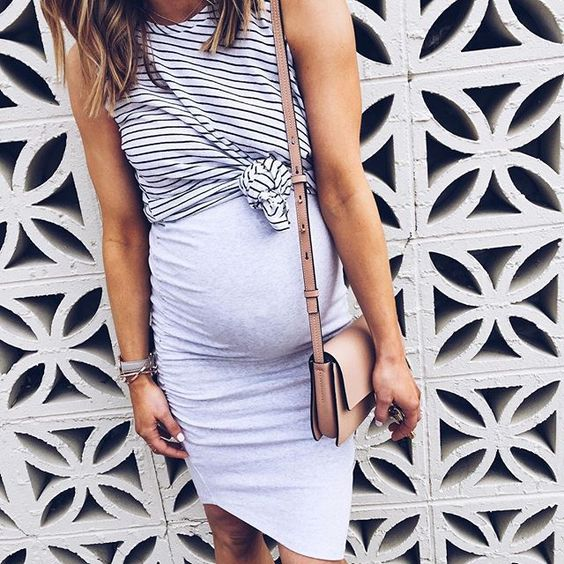 a greay spaghetti dress with a striped sleeveless top and a brown crossbody