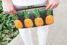 05 a pineapple print clutch is an easy way to add a summer feel to your look