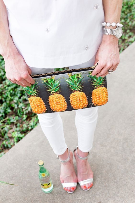 a pineapple print clutch is an easy way to add a summer feel to your look