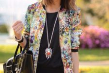 05 black lace mini shorts, a black top and a bold floral blazer and a large tote