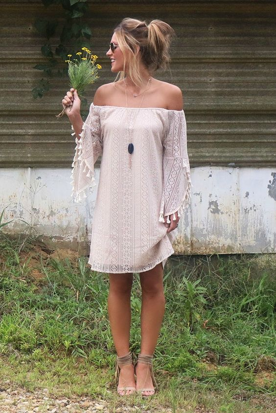 blush boho lace mini dress with tassel sleeves and an off the shoulder neckline, ankle strap heels