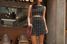 06 a black and white windowpane set with a crop top and a mini skirt, heeled sandals